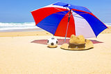 Straw hat, sunglasses and parasol Stock Image