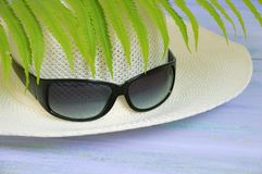Straw hat and sunglasses. royalty free stock photos