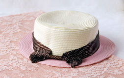 Straw Hat. A sweety straw hat on pink lace Stock Photography
