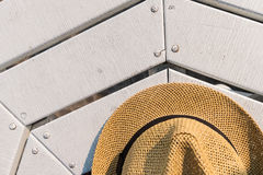 Straw hat on table near the beach. Top view. Straw hat on white table near the beach. Top view Stock Images
