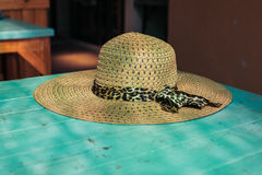 Straw hat on a table Stock Photography