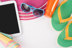 Straw hat tablet and sunglasses on white background.Summer holiday Royalty Free Stock Photography