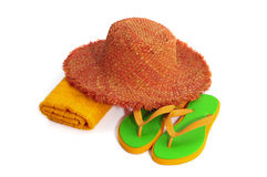 Straw hat, towel, sandal Stock Images