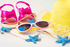 Straw hat, towel, sun glasses and flip flops on white background Stock Photo