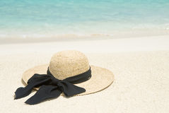 Straw Hat on a Tropical Beach Stock Photography