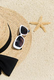 Straw Hat on a Tropical Beach Stock Image