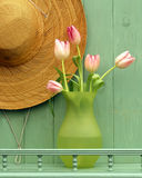 Straw hat and Tulips  Royalty Free Stock Photo
