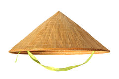 Straw hat from Vietnam on white. Straw hat in the shape of a cone from Vietnam isolated on a white background Stock Photo