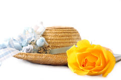 Straw hat w yellow rose Stock Photo