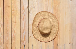 Straw hat on wall Stock Image