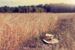 Straw hat was lost on a rural landscape Stock Photo