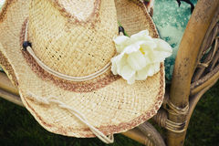 Straw hat with white flower Stock Photography