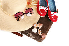 Straw hat wit red shoes on old suitcase Royalty Free Stock Images