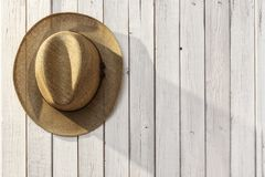 Straw hat on the wooden background Stock Images