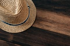 Straw hat on a wooden table with copy space royalty free stock photo