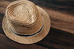 Straw hat on a wooden table with copy space stock photo