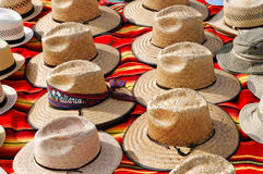 Straw Hats. On a Colorful Carpet stock image