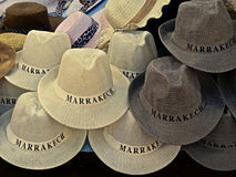 Hats in a souk in Marrakech, Morocco. Straw hats in a souk in Marrakech, Morocco Stock Images