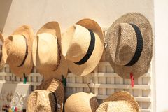 Straw hats souvenirs on sale, Puglia, Italy. stock images