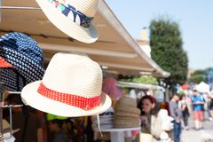 Straw hats stacked up for sale in a store street in shallow focus. A Straw hats stacked up for sale in a store street in shallow focus stock images