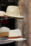 Straw hats on a stand Stock Image