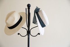 Straw hats. Two straw hats on a coat stand. copy space Stock Images