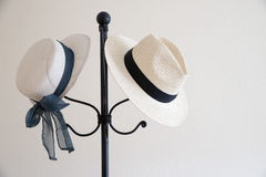 Straw hats. Two straw hats on a coat stand. copy space Royalty Free Stock Photography