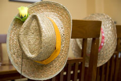 Straw hats on wooden chairs Royalty Free Stock Photo