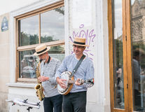 Straw-hatted busker smiles at the camera, Paris Royalty Free Stock Photo