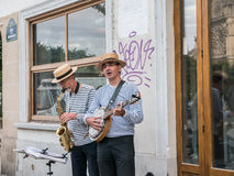 Straw-hatted buskers near Notre Dame in Paris Royalty Free Stock Image