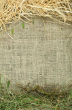 Straw and hay on burlap Royalty Free Stock Image