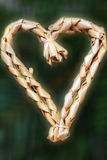 Straw heart for the Christmas tree, isolated Royalty Free Stock Images