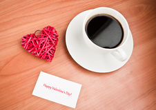 Straw heart and cup of coffee Stock Photography