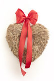 Straw heart with red ribbon on white background. Straw made heart Royalty Free Stock Photography