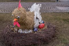 Straw hen with colorful eggs stock photo