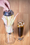 Straw holder and cola with ice Royalty Free Stock Photography