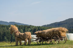Straw horse stuffed with straw wagon Royalty Free Stock Photos