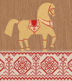Straw horse. Vector illustration. Wooden horse a symbol of New year 2014. Folklore style. Figurine and national embroidery Stock Images