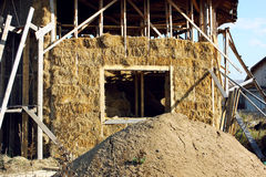 Straw house with a roof. Hexagonal house from straw bales with a roof stock image