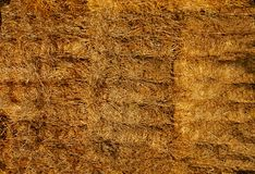 Straw in huge square bales lying on top of each other .Texture or background. The straw is pressed into huge bales lying on top of each other .Texture or royalty free stock photography