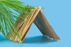 Straw hut. Summer straw hut on a blue background Stock Photo
