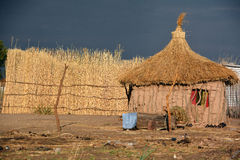 Straw hut. BANGANI NAMIBIE OCTOBER 10: Straw hut in town of Bangani on october 10 2014. In Namibia About 27.6 per cent of households are classified as poor Stock Photo