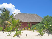 Straw hut on a beach. With white sand - Tulum - Mexico Stock Photo
