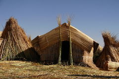 Straw Hut on Floating Island in Peru Royalty Free Stock Image