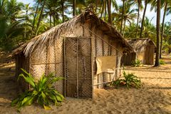 Straw hut on Paradise beach in Goa Stock Photo