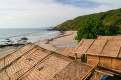 Straw hut roofs and beach view goa india Royalty Free Stock Image