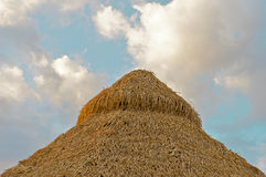 Straw hut in the tropics. Top of a straw hut surrounded by a beautiful blue sky on a resort in tropical Costa Rica Stock Images
