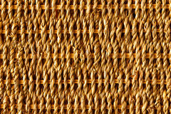 Straw Interlace. Background of rustic interlaced straw of a handmade craft Royalty Free Stock Photo