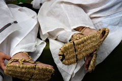 Straw Japanese sandals. The feet of two young men wearing traditional straw sandals and costumes prior to the start of a festival parade in Kyoto, Japan stock image