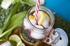 Straw in juice mug Royalty Free Stock Images